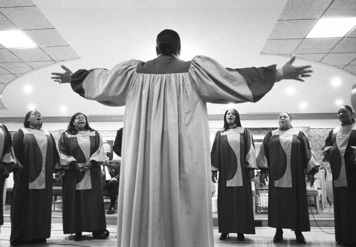 Cedric Mangum's wife leads the vocal choir.
