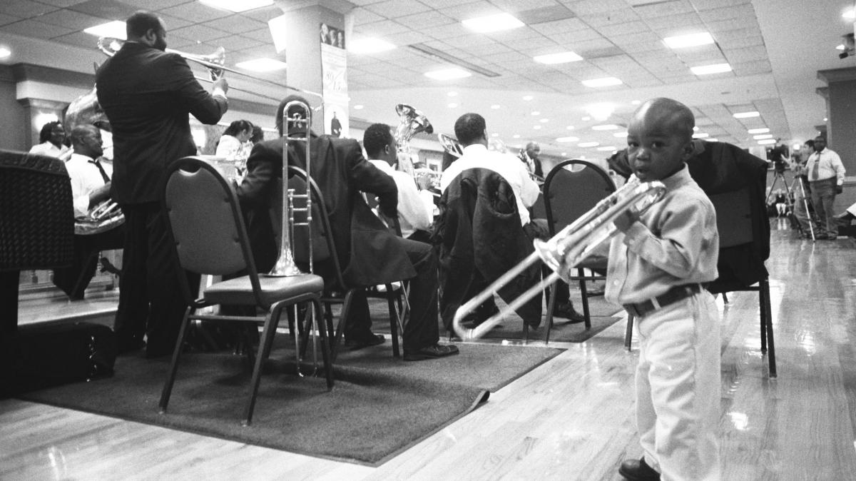 Cedric Mangum (left) leads the shout band as a junior member looks on.