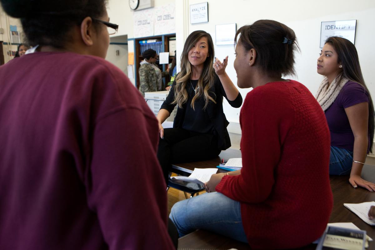 Yarenis Sanches, 16 (from left), Daliyah Middleton, 15, and Anna Lam, 15, listen as Park leads her 10th-grade English honors class in an interactive discussion at TechBoston Academy.