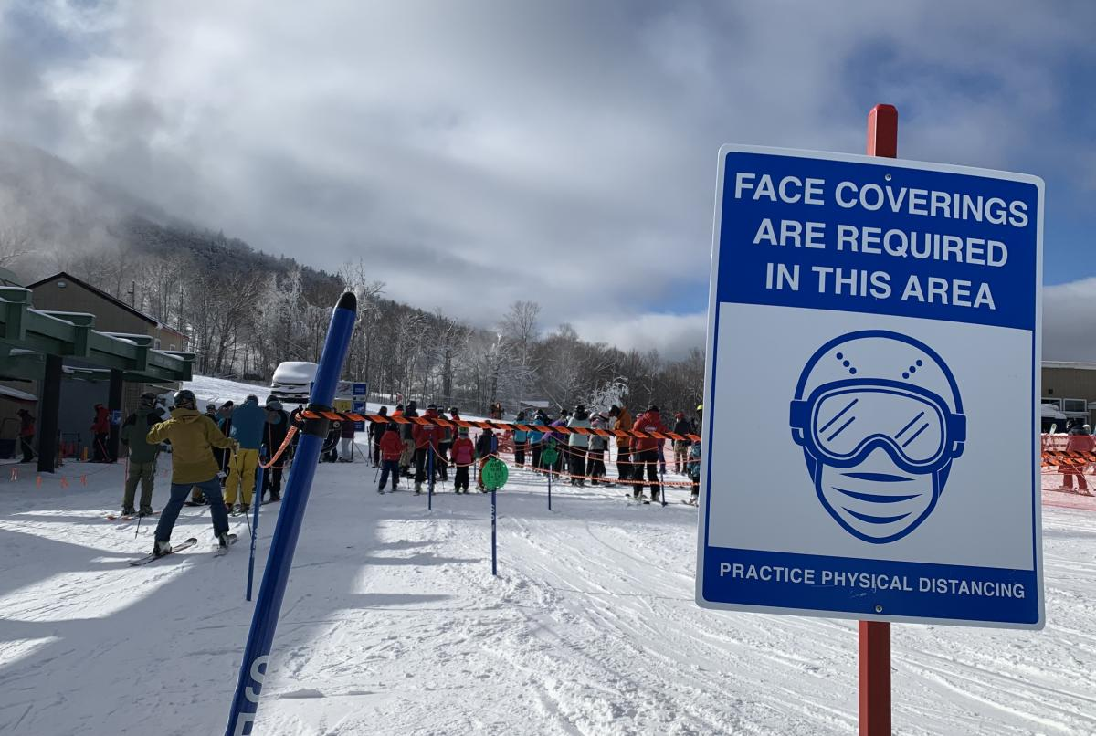 In the lift lines waiting to get on a chair to head up the mountain, skiers and boarders are reminded to wear masks by signs and attendants with little bullhorns. The lines are also more spread out with every other row empty. These are called 'ghost lines