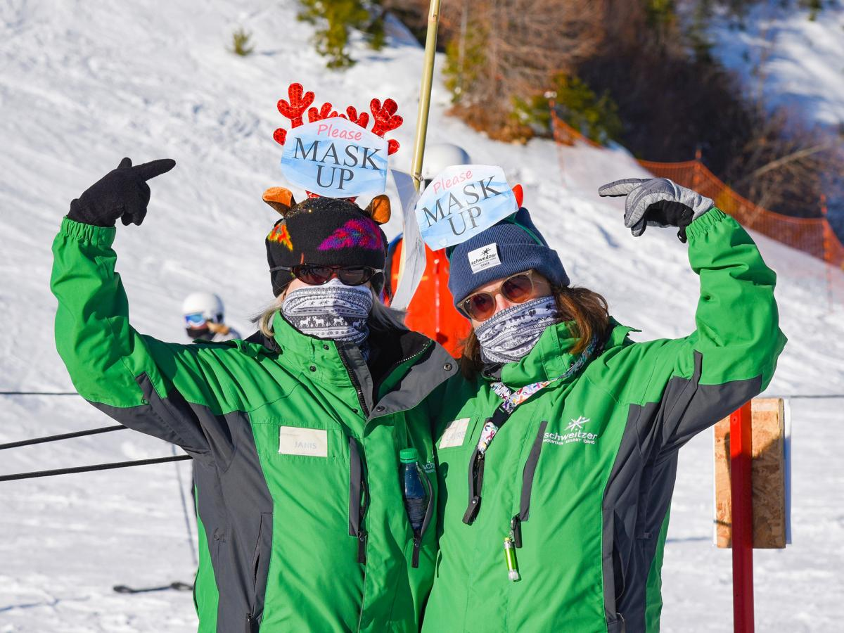 """Lift line attendants at Schweitzer Mountain remind skiers and boarders to wear their masks. The ski area's president Tom Chasse says, """"95% of the people here, they get it. they're totally on board. They want us to stay open through the whole season."""""""