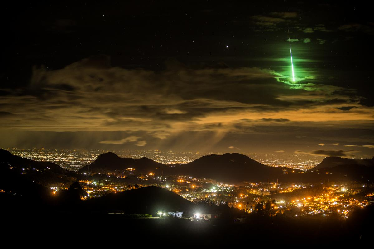 A green meteor glimmers above mountaintops in the Western Ghats of southern India.
