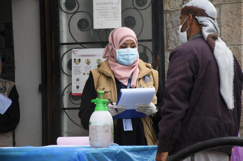 Dr. Nebras Khaled screens patients for symptoms of COVID-19 at a health facility in Sana'a, Yemen.