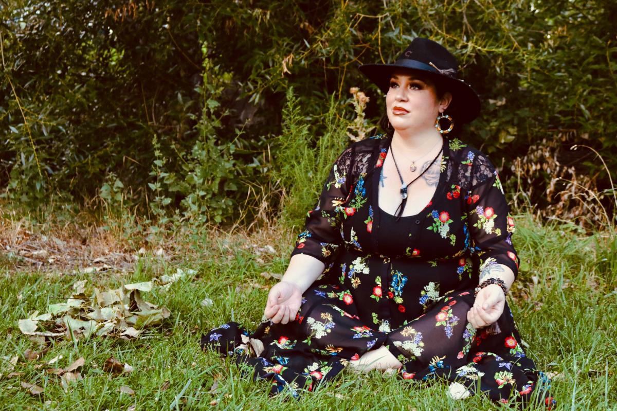 Naomi Ochoa sits in a park in Denver.