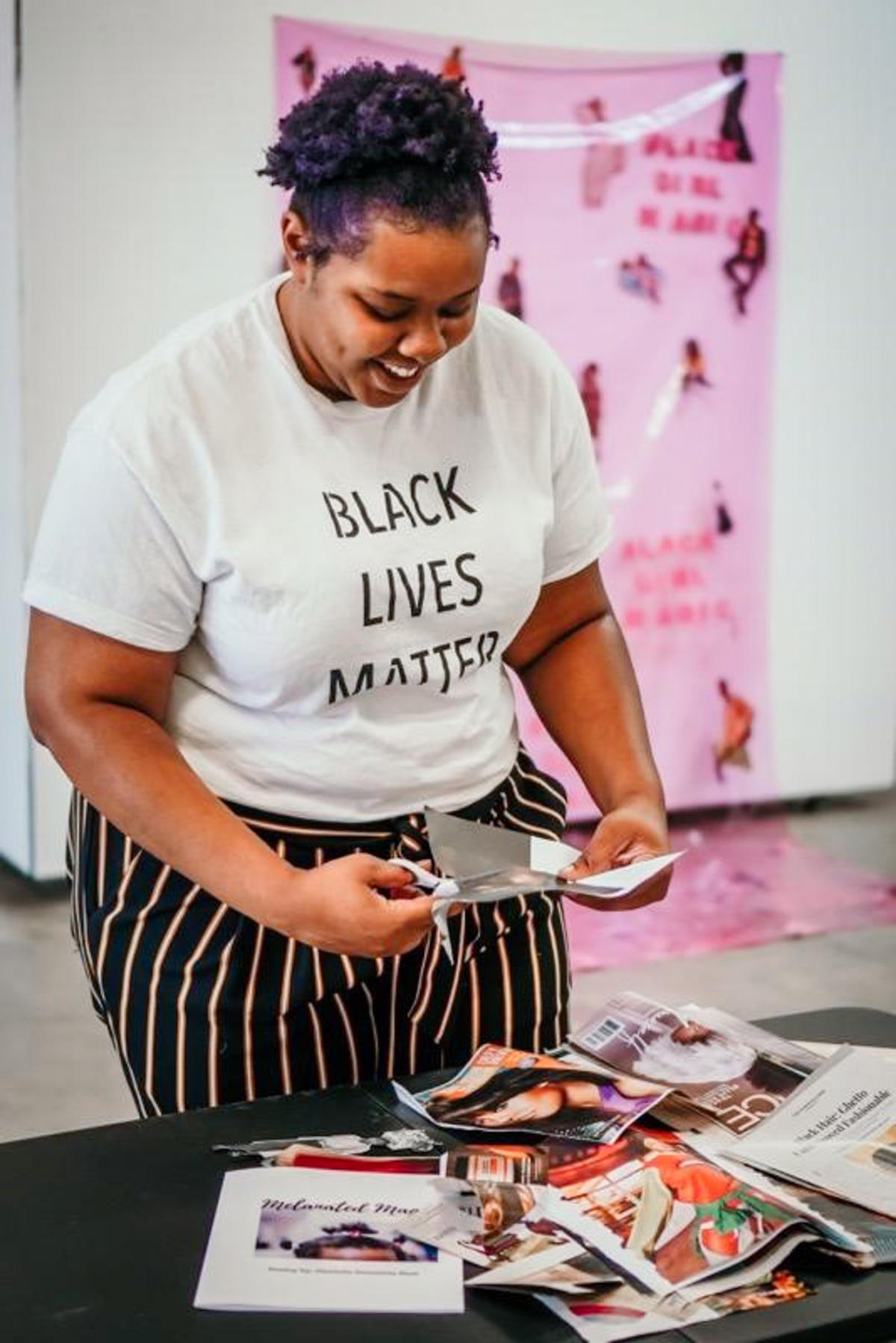 Danielle Demetria East cuts magazines for a collage in her studio in Lubbock, Texas.