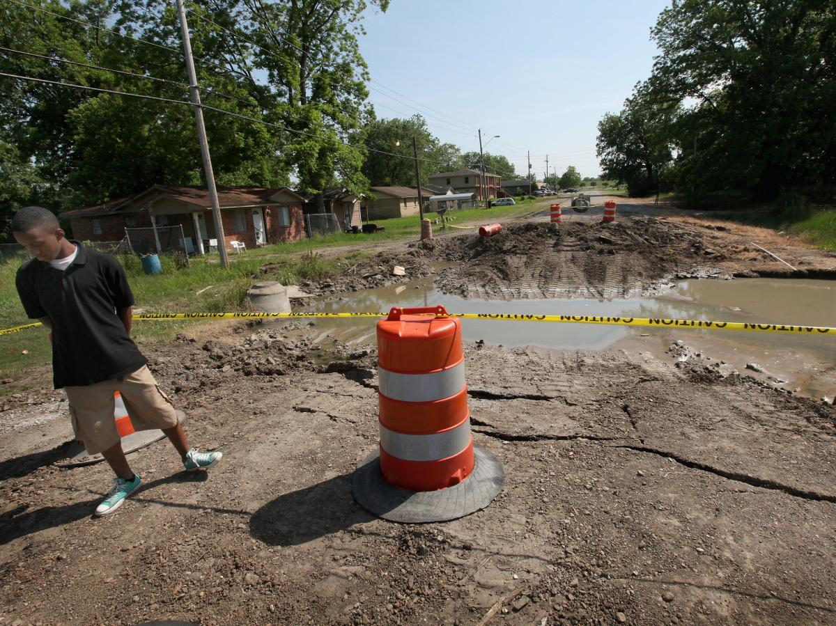 Water that came under a levee in Greenville, Miss., in 2011 caused this street to collapse. The city has had major floods twice since then, including record-breaking high water this year. Greenville's mayor says many residents live in low-lying areas serv