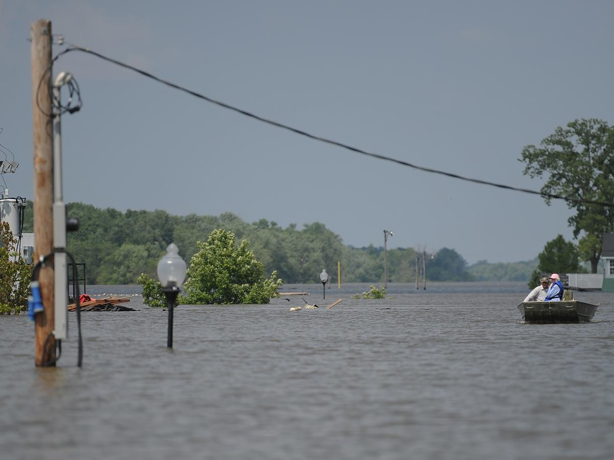 Boats replace cars as a mode of transportation in Grafton, Ill., in June 2019 after the Mississippi River flooded part of the town.