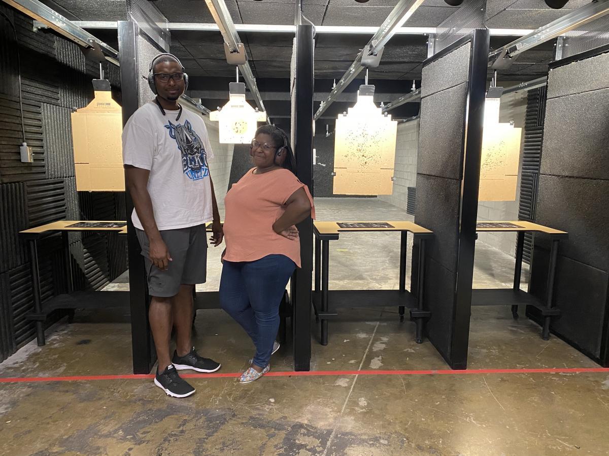 Kat Traylor and her husband Kevin Cox at a gun range.