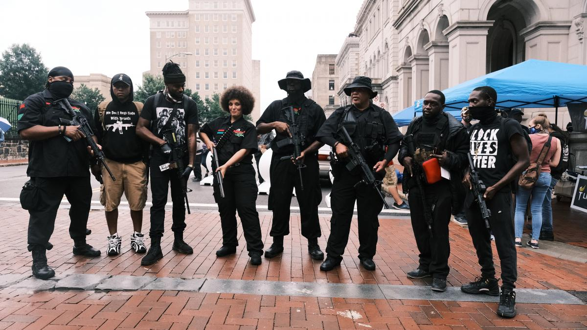 Demonstrators pose for photos with their guns during an open carry rally on Aug. 15 in Richmond, Va. The open carry rally is organized by an activist group known as BLM757 in support of the Black Lives Matter movement and the Second Amendment.