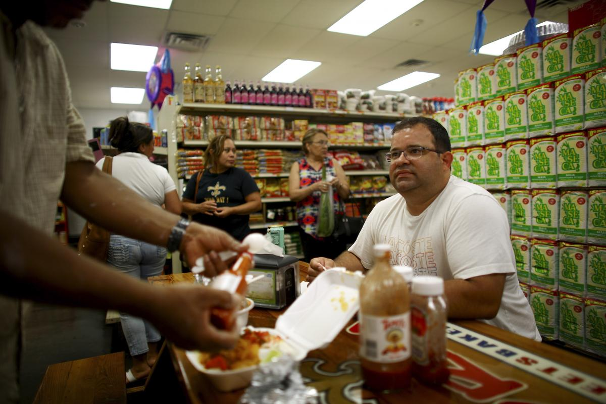 Jose Castillo, manager of Norma's Sweets Bakery, sits in the shop's dining area.
