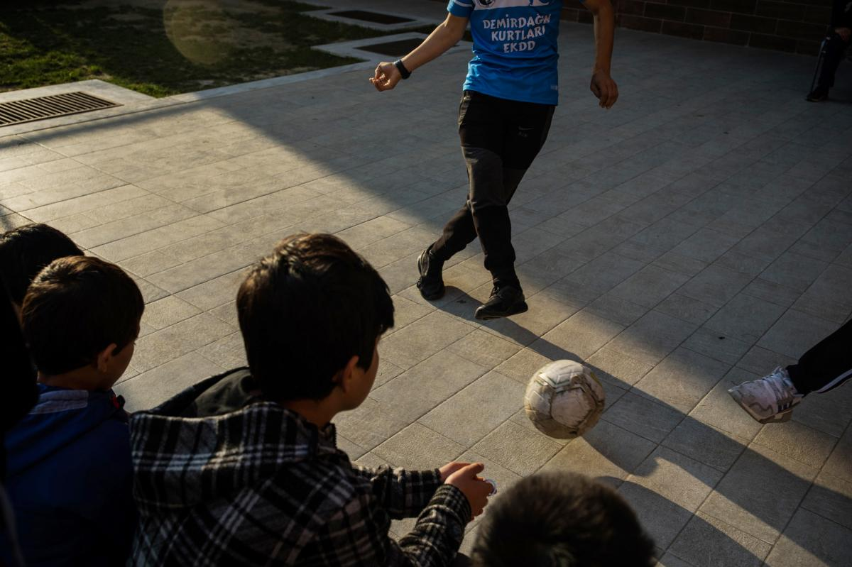 Students watch a soccer game before the start of classes at Oku Uygur boarding school on the outskirts of Istanbul. The school cares for dozens of children, including some whose parents have been imprisoned in Xinjiang, in China's northwest.