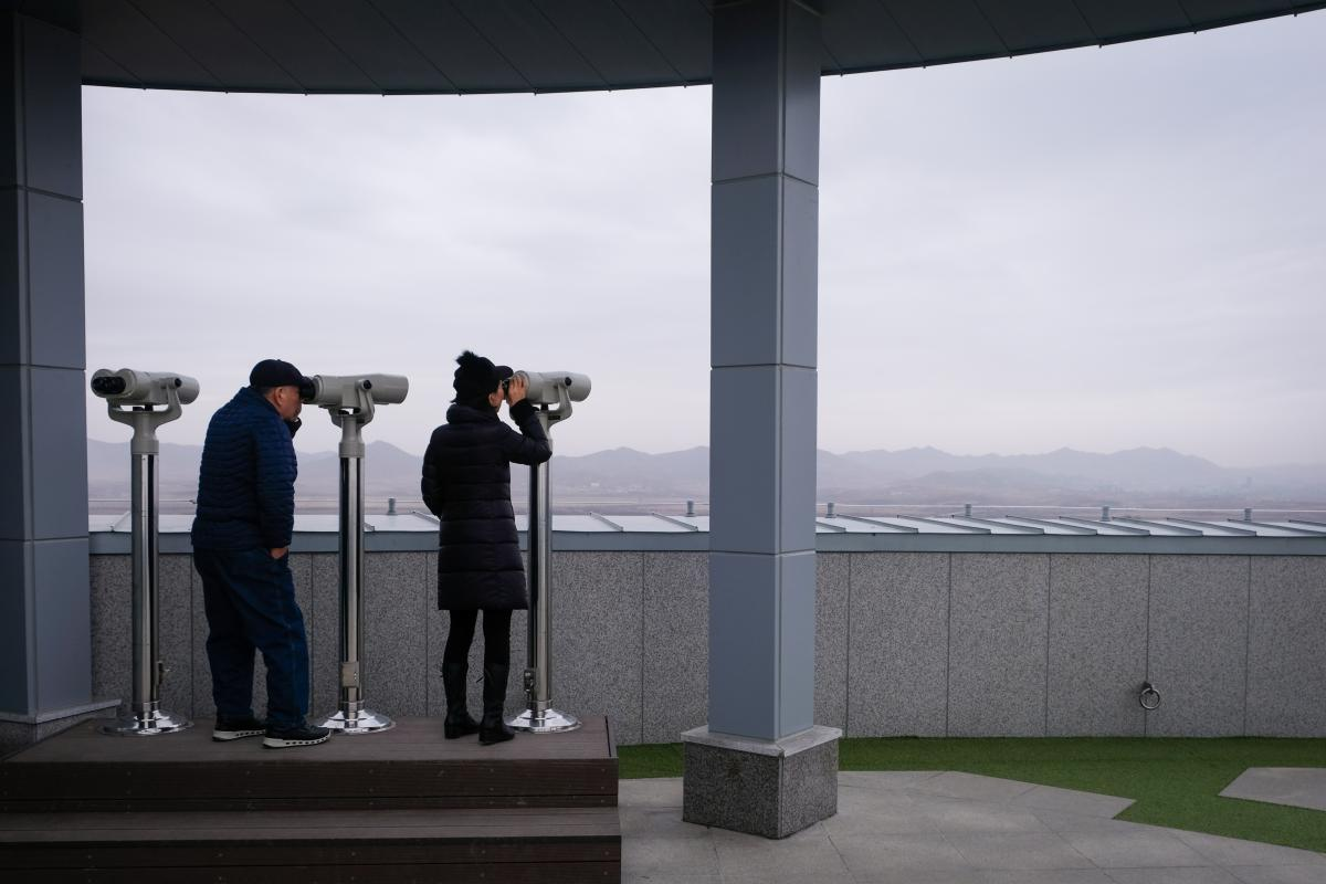 Visitors look into North Korea from the Dorasan observatory.