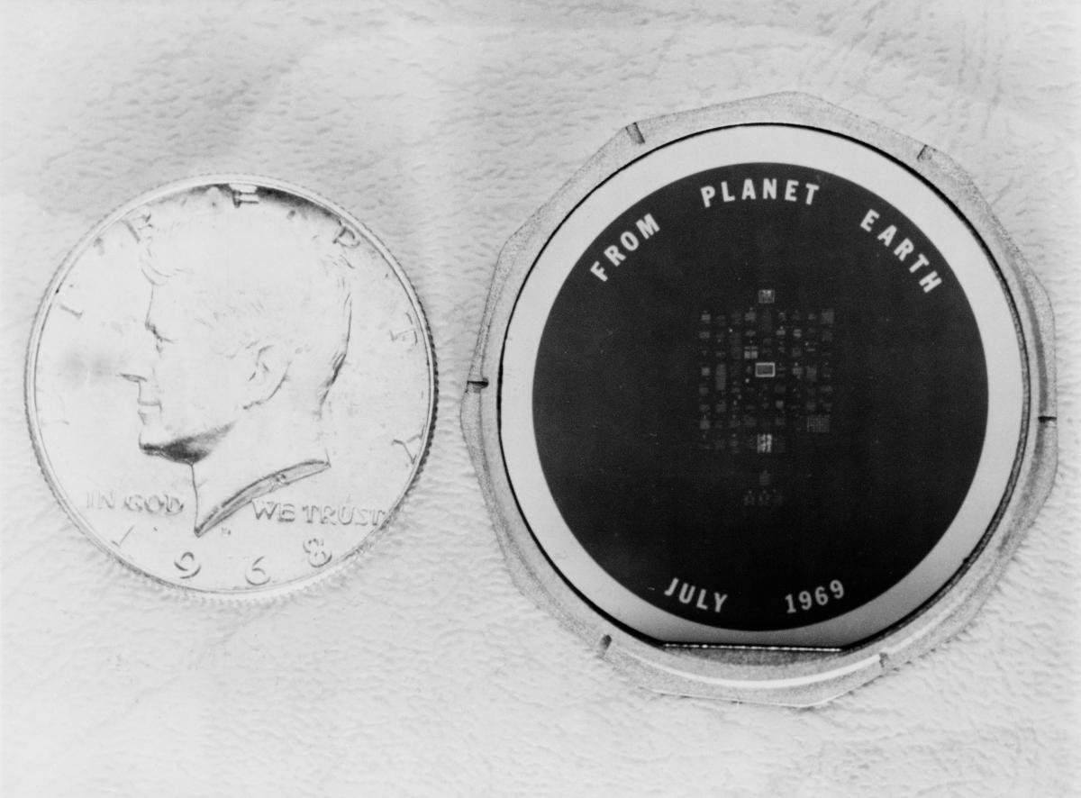 The 1 1/2-inch silicon disk left on the moon by the Apollo 11 astronauts bears messages of goodwill from many heads of state. The process used to make this wafer is the same as that used to manufacture integrated circuits for electronic equipment.