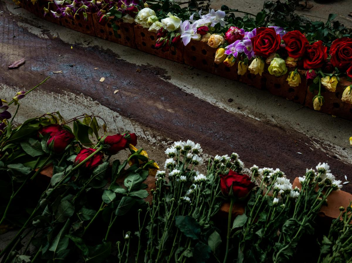 Flowers line the street next to dried blood at the spot where Chit Min Thu, 25, was killed in clashes on March 11 in Yangon, Myanmar. The military junta cracked down brutally on a nationwide civil disobedience movement in which thousands of people have tu