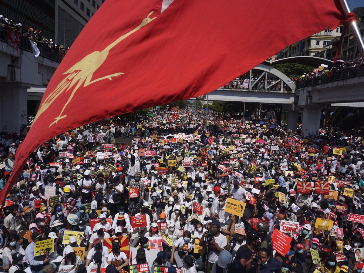 Protesters block a major road during a demonstration against the military coup in Yangon on Feb. 17.