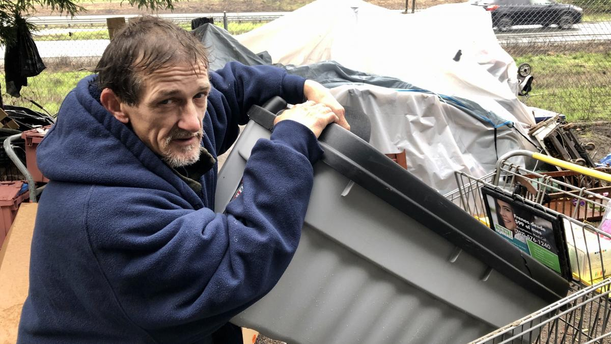 """Charles Gibson, who goes by the nickname """"Cowboy,"""" lives at the tent city in Santa Rosa, Calif. """"It's a struggle for anybody to keep warm and keep your heart and head light and strong,"""" he says. """"I'm doing the best I can."""""""