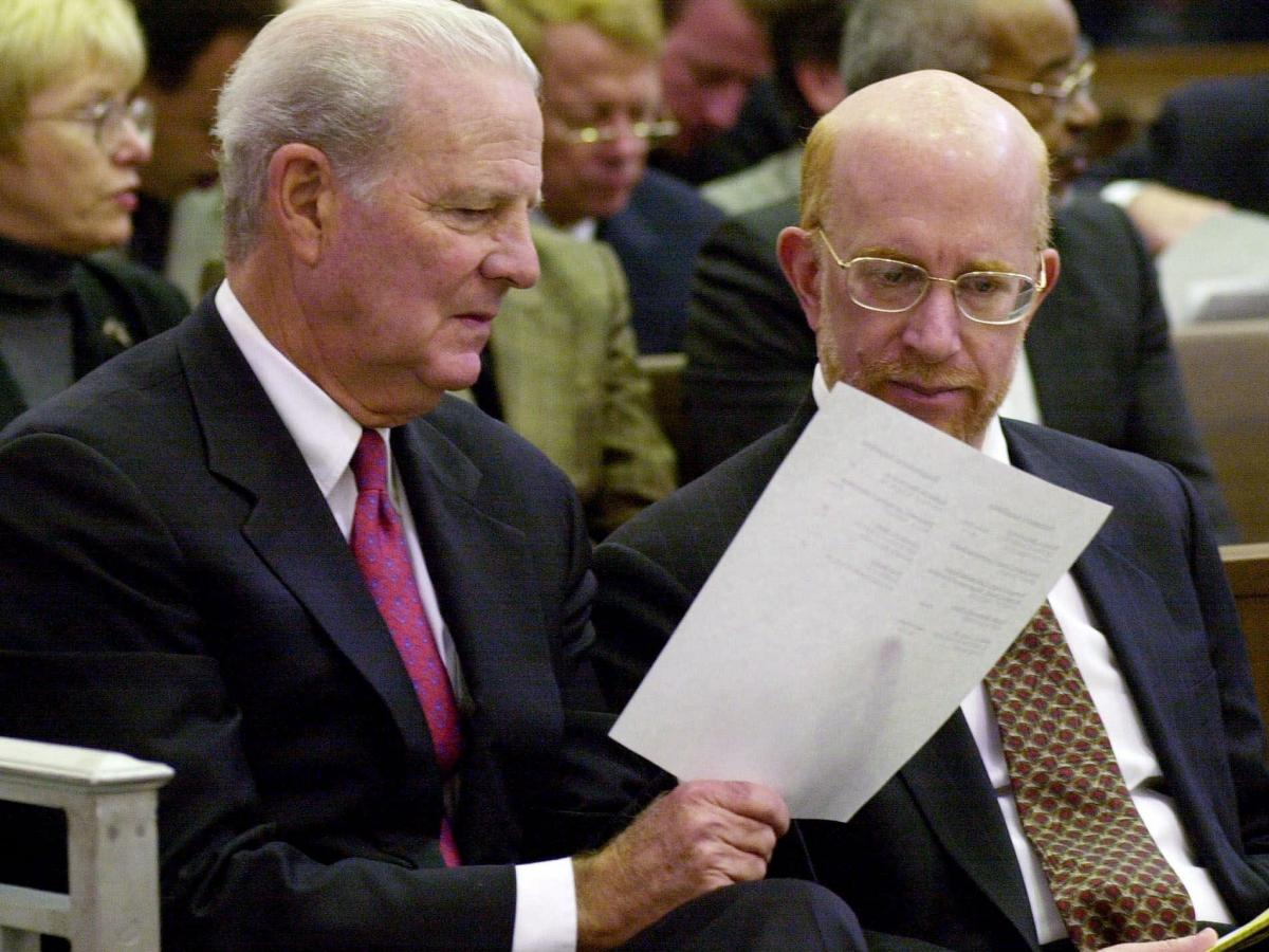 Former Secretary of State James A. Baker (left) confers with attorney Ben Ginsberg before the start of a hearing in the Florida Supreme Court in the days after the 2000 election.