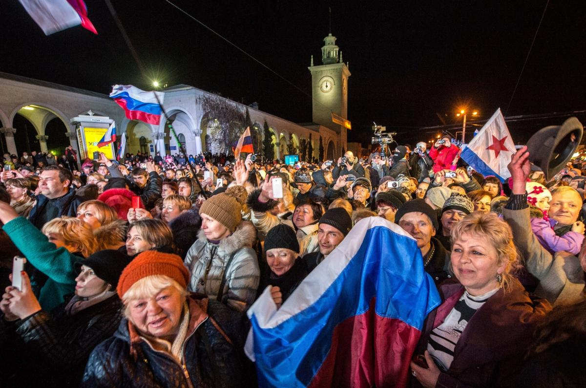 People in Crimea celebrate the transition to Moscow time near a city clock tower at a railway station in Simferopol on March 30.