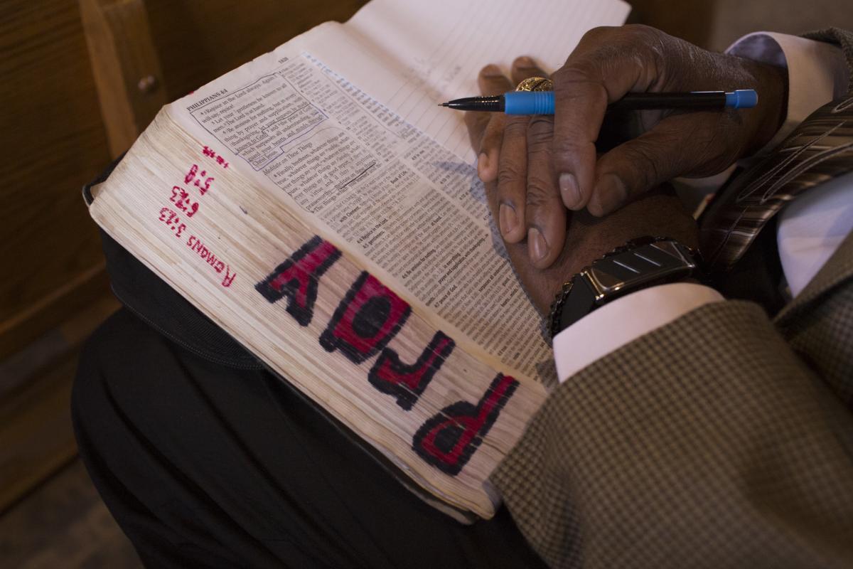 Charleston attends a men's Sunday school session.