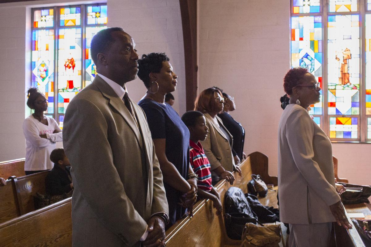 Ga'verri Jones-Collins attends a Sunday worship service with his grandparents, Charleston and Mary.