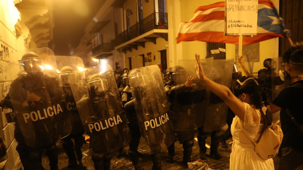 Demonstrators and police face off during a protest against Ricardo Rosselló, the governor of Puerto Rico, on Wednesday in Old San Juan. It was the fifth day in a row of protests in the U.S. territory.