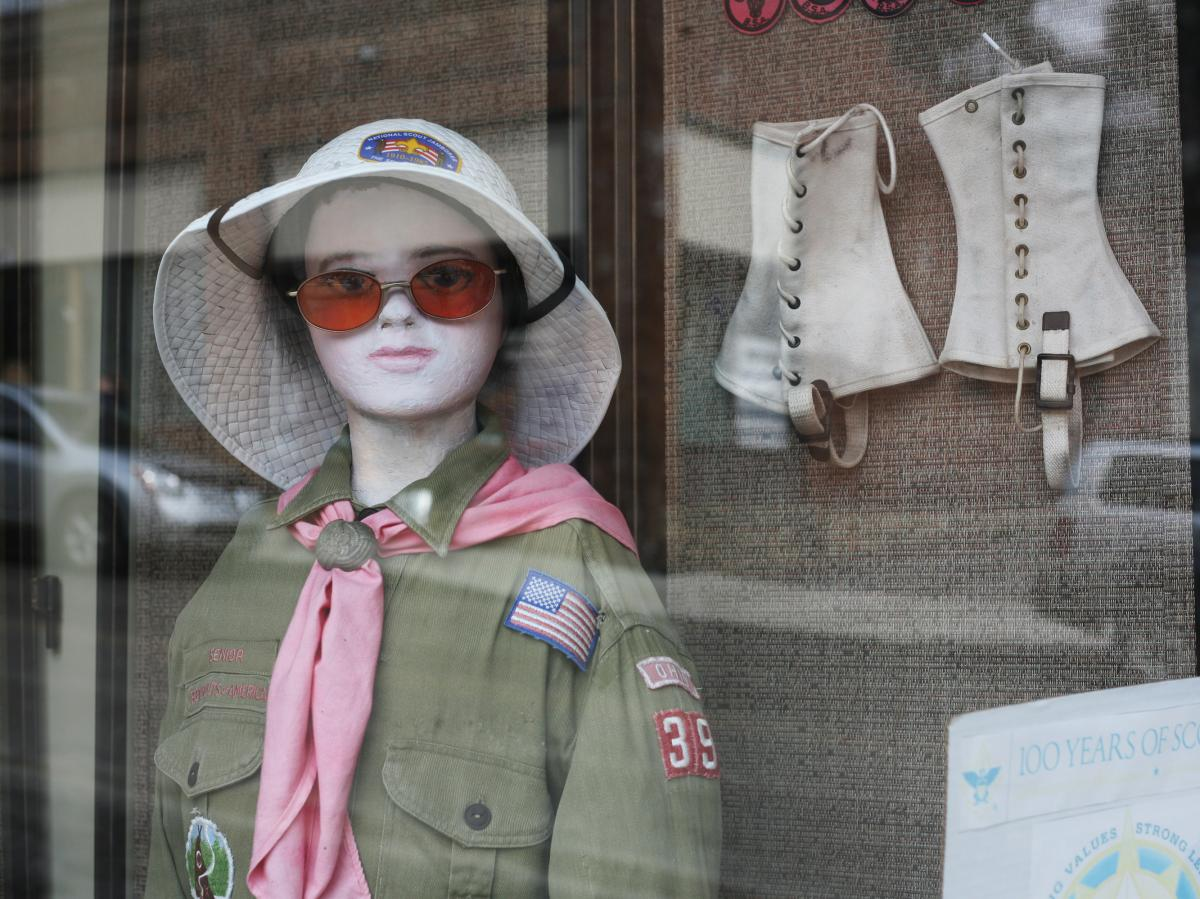 A mannequin in the window of an odds-and-ends store in downtown Mount Hope sports an assortment of Boy Scout-related paraphernalia.