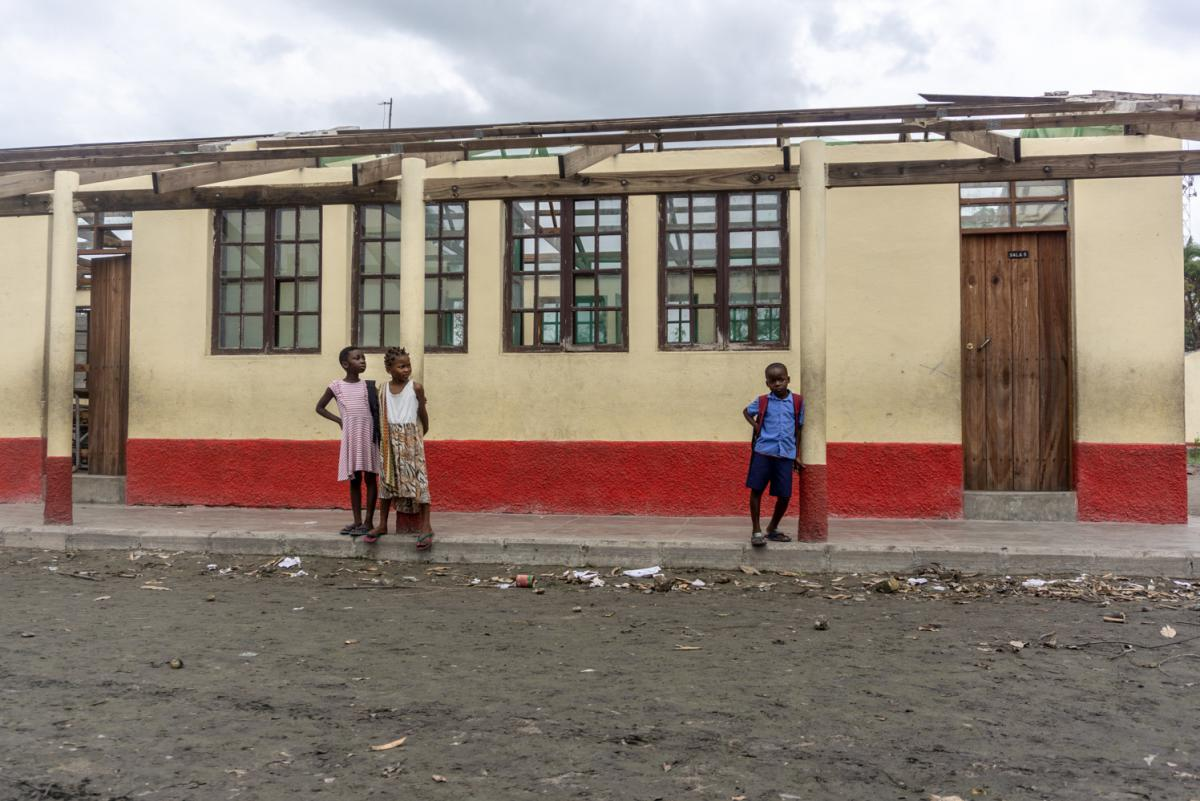 Students at the Eduardo Mondlane school stand next to classrooms destroyed by Cyclone Idai.