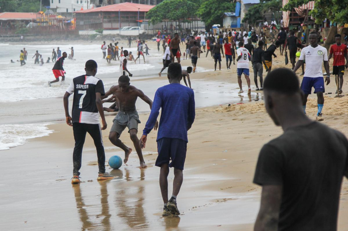 """Everybody who's anybody is at the beach in Freetown on Sundays. """"Just stand here and you can see all sorts all sorts of human beings, you know people from everywhere, every walk of life,"""" says Abdul Rahman Swaray, a local professor. """"Everybody I can tell"""