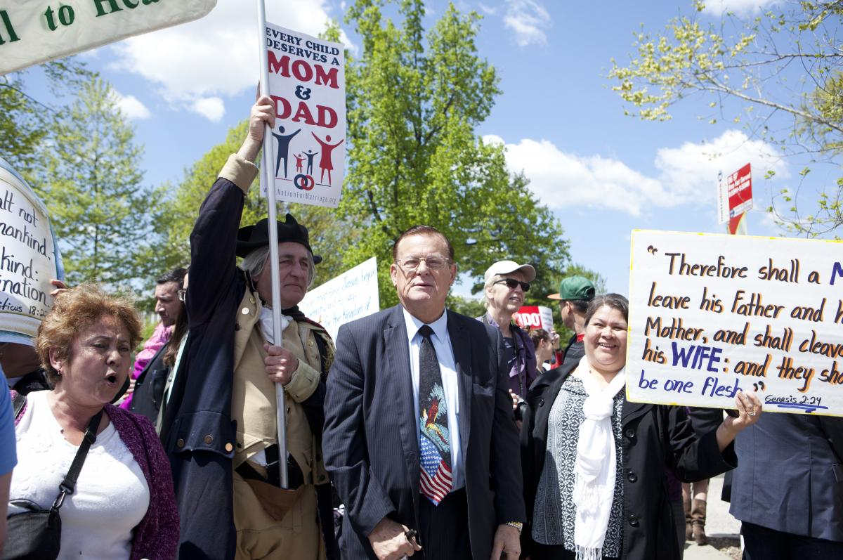 Demonstrators with the National Organization for Marriage protest against same-sex marriage outside of the Supreme Court on Tuesday.