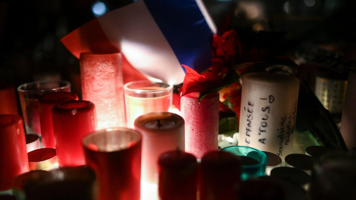 During a memorial vigil on Thursday, candles mark the scene of the Strasbourg, France, Christmas market shooting.