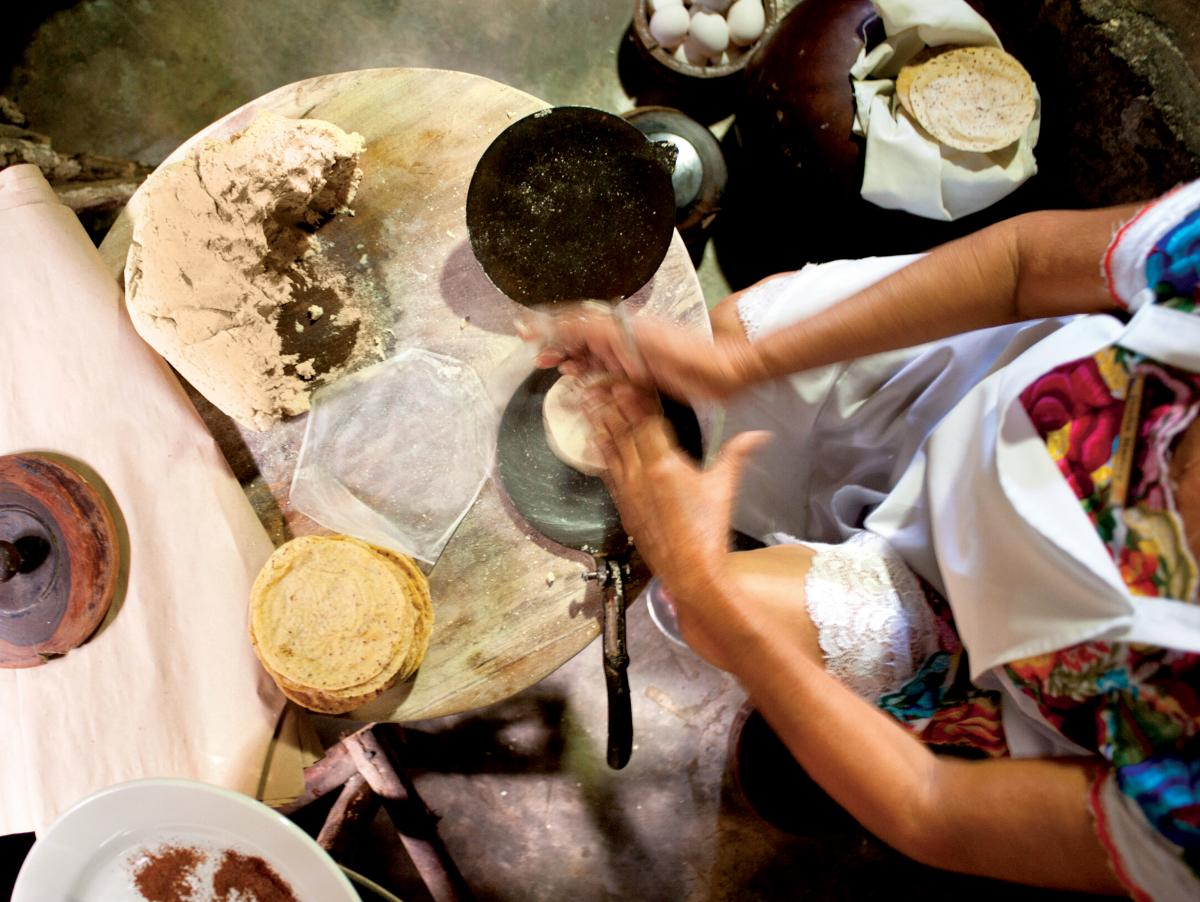 A woman prepares tortillas at Kinich Restaurant in Izamal, Yucatan, Mexico. The average Mexican consumes 135 pounds of tortillas per year.