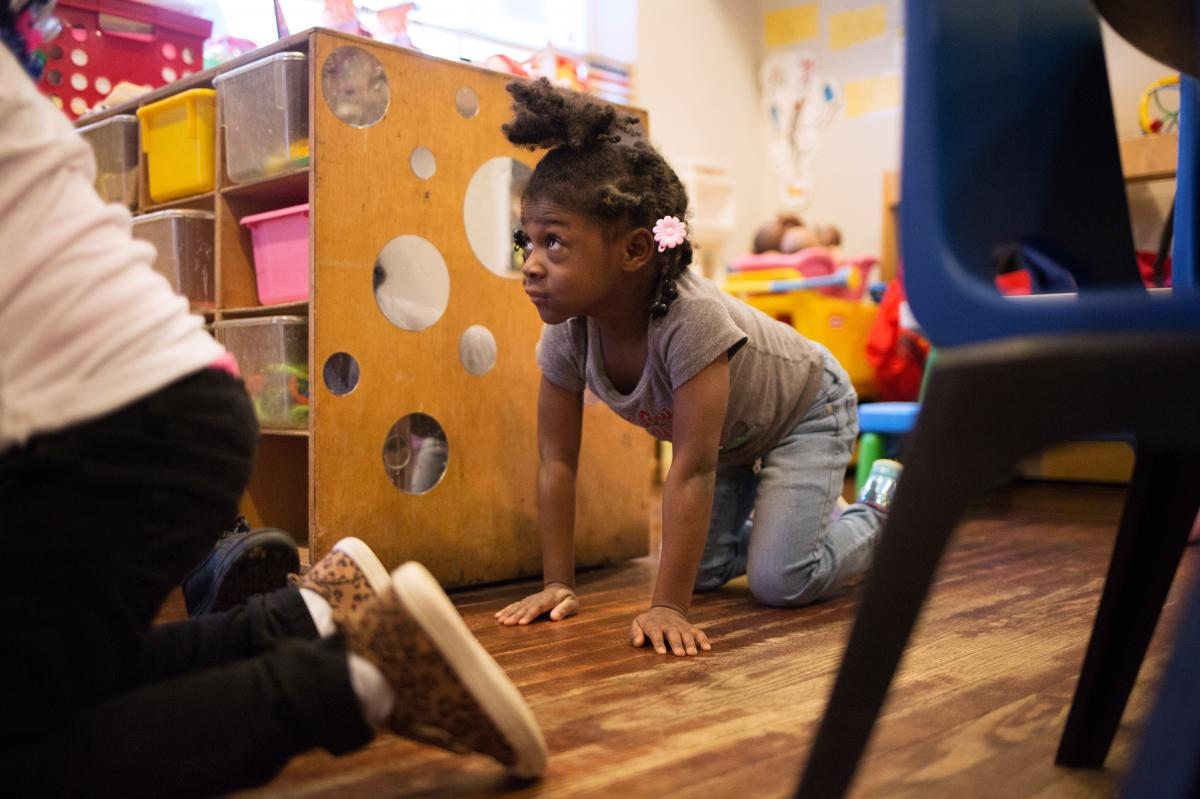 """Justice Buress, 4, demonstrates how she drops to the floor when she hears her teacher call out """"Dora the Explorer"""" during monthly drills at Little Explorers Learning Center."""
