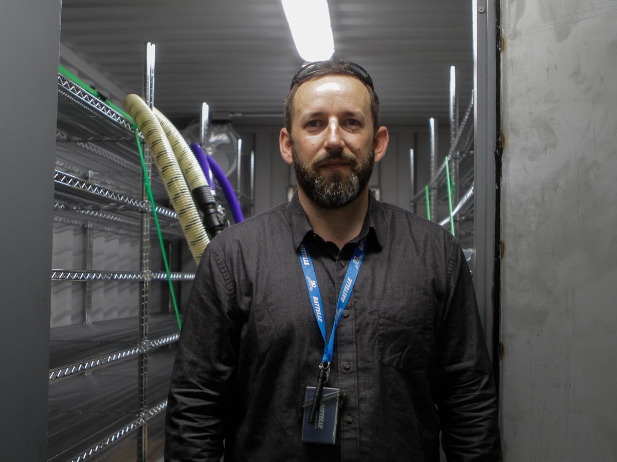 Researcher Will Richter stands inside a decontamination chamber.