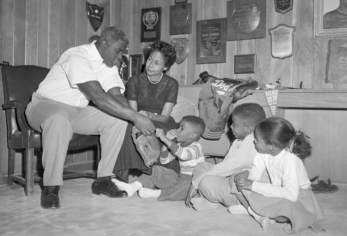 Jackie Robinson and his family sit in the trophy-decorated den of their home in January 1957. From left, Jackie, Rachel, David, Jackie Jr. and Sharon.