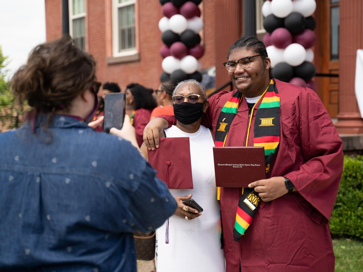 Michael Blackson and other students picked up their cap and gowns recently. Michael graduates with honors on June 19.