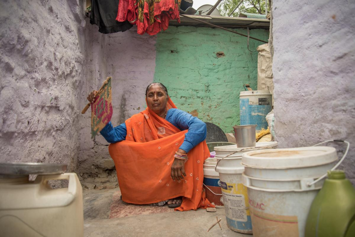 Bhagwati Devi, 59, sits in her two-room home, surrounded by jerrycans and buckets in which she stores water that's delivered. The communal tap for her neighborhood dried up two years ago.