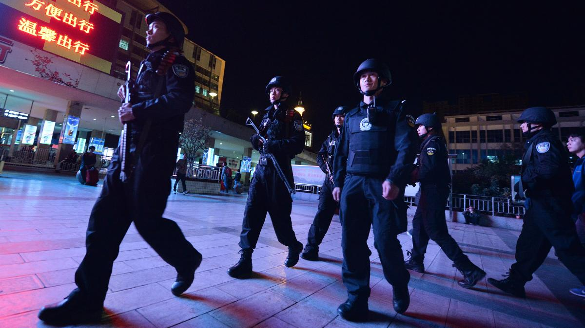 Chinese armed police patrol the main train station in Kunming, in China's southwestern Yunnan province, on March 2. In another attack the Chinese government blamed on Uighur militants, knife-wielding assailants killed 29 people and injured more than 130 i