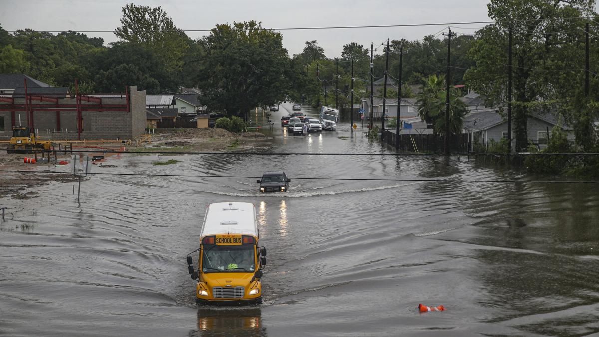 A school bus makes its way through a flooded section of Hopper Road in Houston on Thursday. Texas Gov. Greg Abbott has declared much of southeast Texas disaster areas after heavy rain and flooding from the remnants of Tropical Depression Imelda.