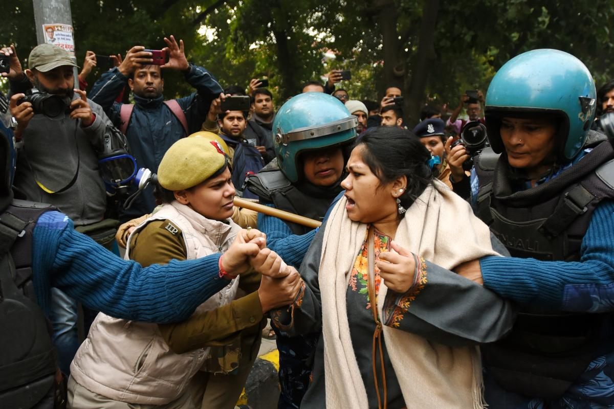 Police detain a demonstrator in New Delhi in December 2019. Countrywide protests continued throughout India in December as public anger grew over new changes to citizenship laws.