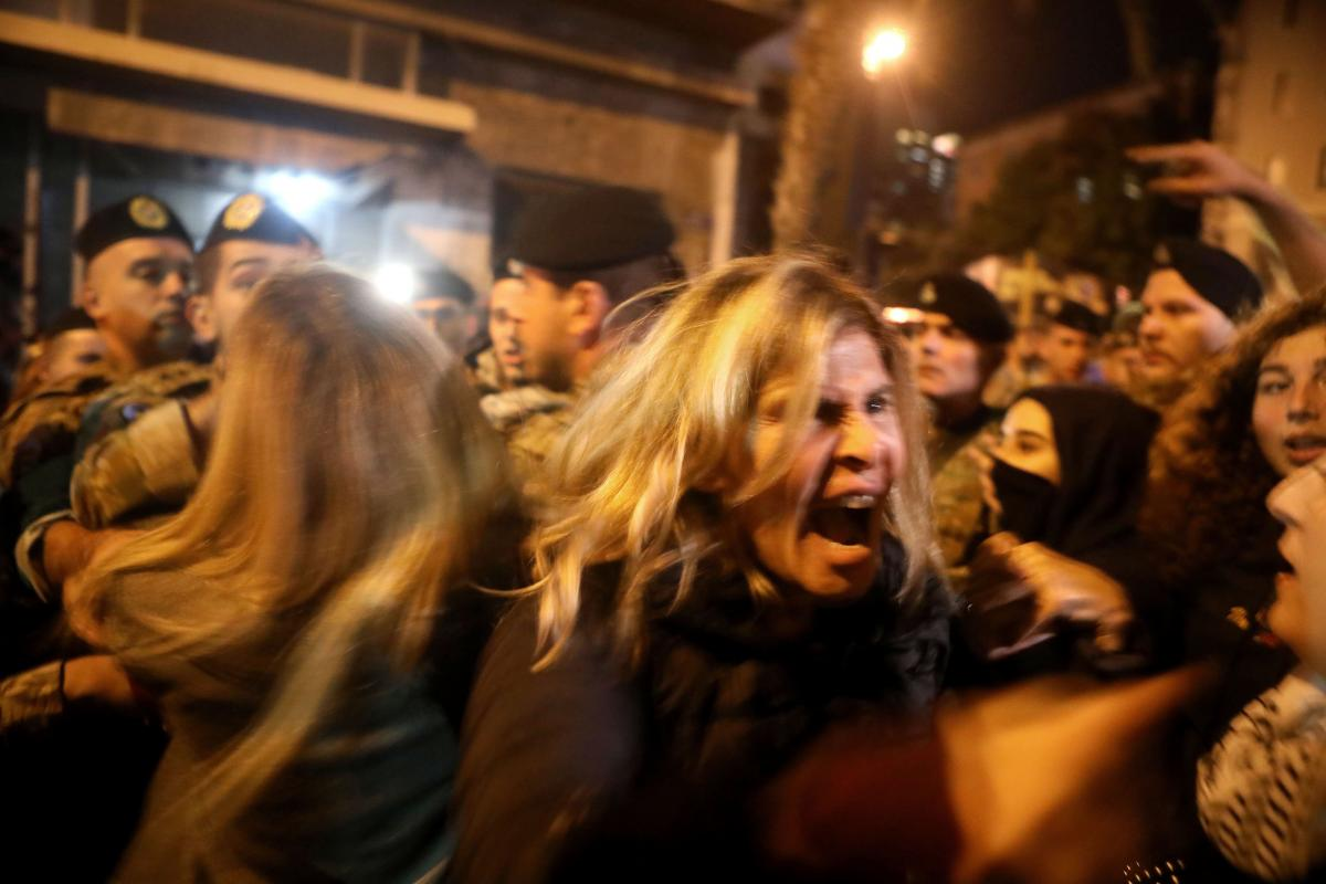 Lebanese anti-government protesters scuffle with riot police in Beirut in December 2019. The protests, which began in October, brought the country to a standstill amid a downward economic slide.