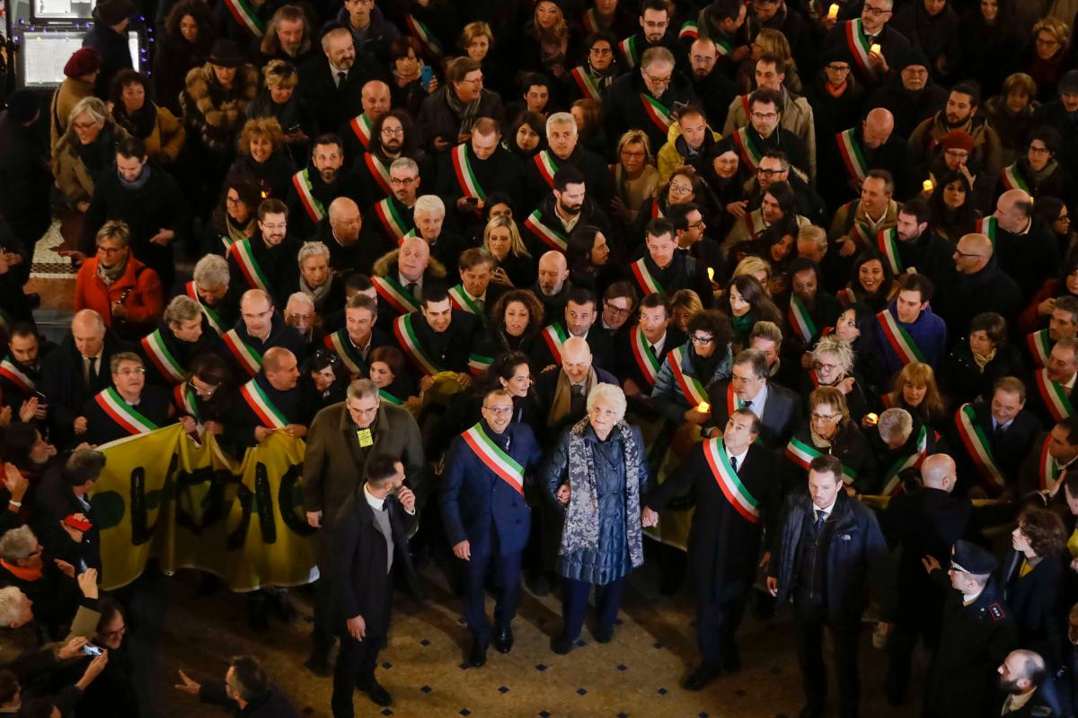 Liliana Segre (center), an 89-year-old Holocaust survivor and Italian senator for life, attends an anti-racism demonstration in Milan, joined by 600 Italian mayors, in December 2019. Amid rising nationalistic and anti-immigrant sentiment in Italy, Segre w