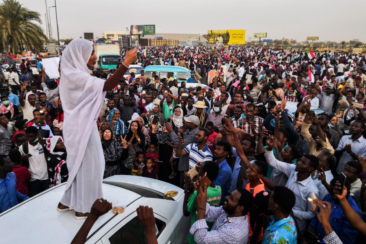 Standing on a white car and wearing a traditional white thobe, Sudanese student Alaa Salah led protest chants against longtime dictator President Omar al-Bashir in Khartoum in April 2019. A social media post showing a photo of Salah went viral, and she wa