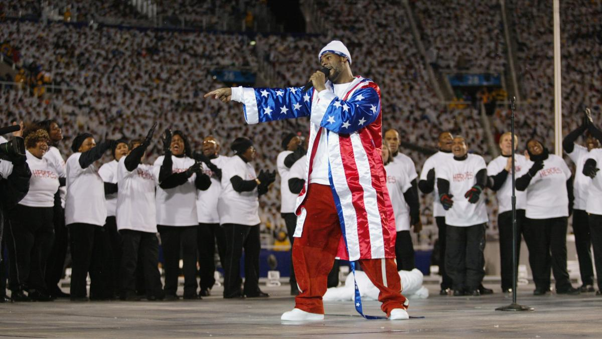 R. Kelly performs at the opening ceremony of the 2002 Winter Olympics in Salt Lake City, Utah. That very same day, Feb. 8, Chicago police revealed their investigation into allegations that the singer had filmed himself having sexual relations with an unde