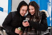 Eino Taunajik and Kamilla Larsen watch a music video during a break from the suicide prevention course in Tasiilaq.