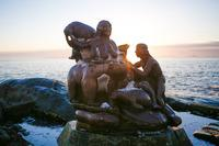 A bronze sculpture of the Inuit Mother of the Sea sits in Nuuk's colonial harbor in the shadow of Nuuk's oldest Danish church. According to legend, she is the source of Greenland's prosperity.