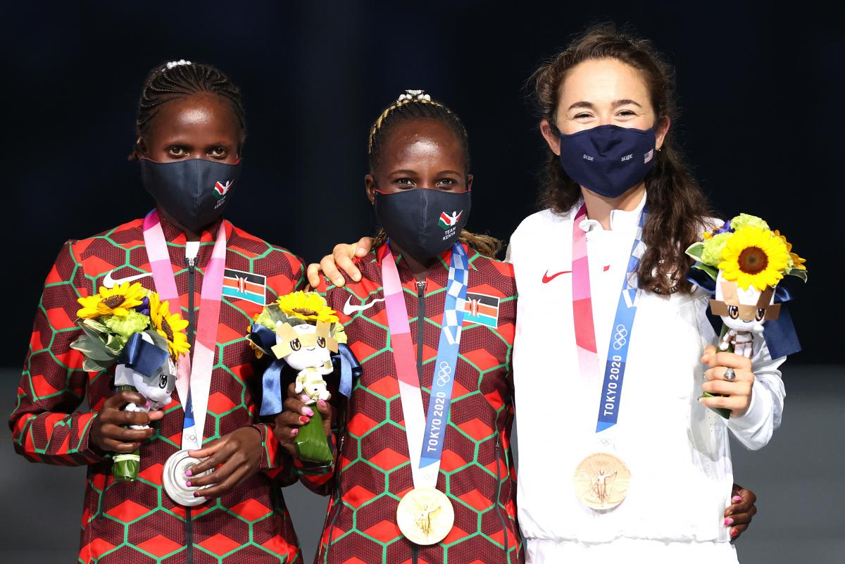 Silver medalist Brigid Kosgei, left, of Team Kenya, gold medalist Peres Jepchirchir, center, of Team Kenya and bronze medalist Molly Seidel of Team United States pose during the medal ceremony for the Women's Marathon Final during the Closing Ceremony of