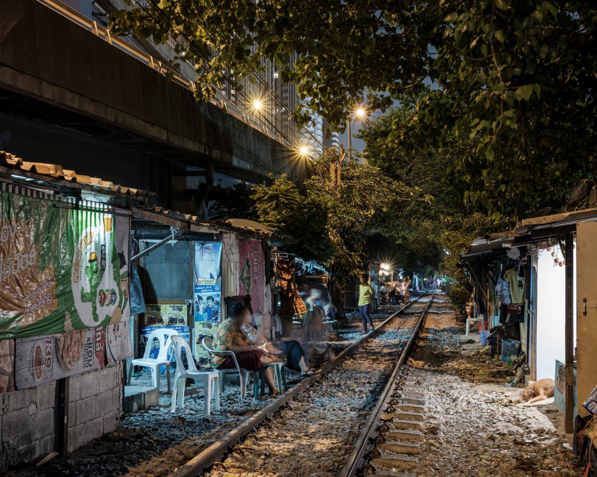 In Bangkok, communities of poor people live under expressways and besides train tracks. They have been especially hard-hit by the economic downturn triggered by Thailand's efforts to suppress COVID-19.