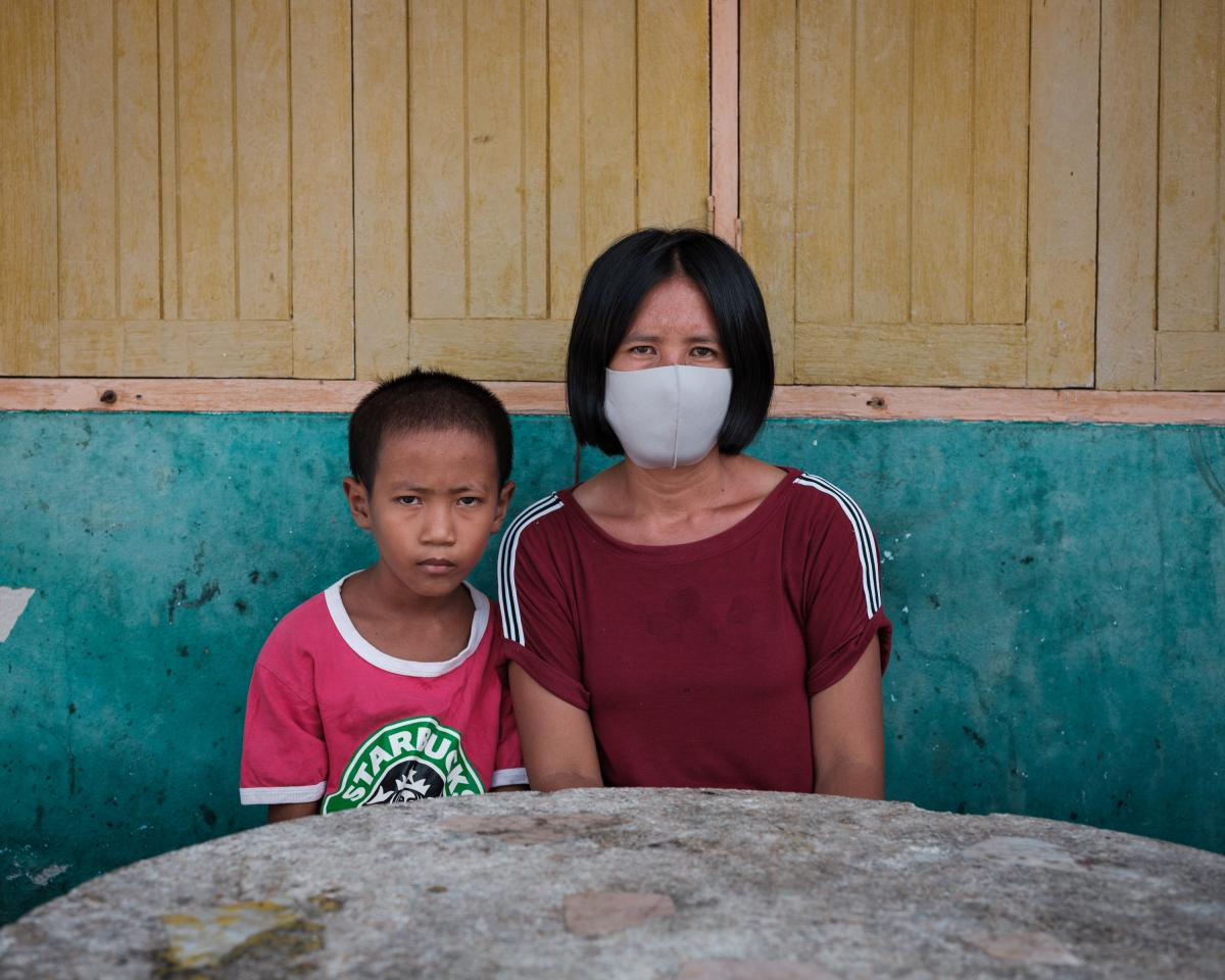 Pranee Thermuangpak, 38, with one of her three children. Pranee's husband, Samart Thermuangpak, a construction worker, tried to kill himself after his application for the 5,000 baht in government aid was denied. Pranee is epileptic and unable to work; her