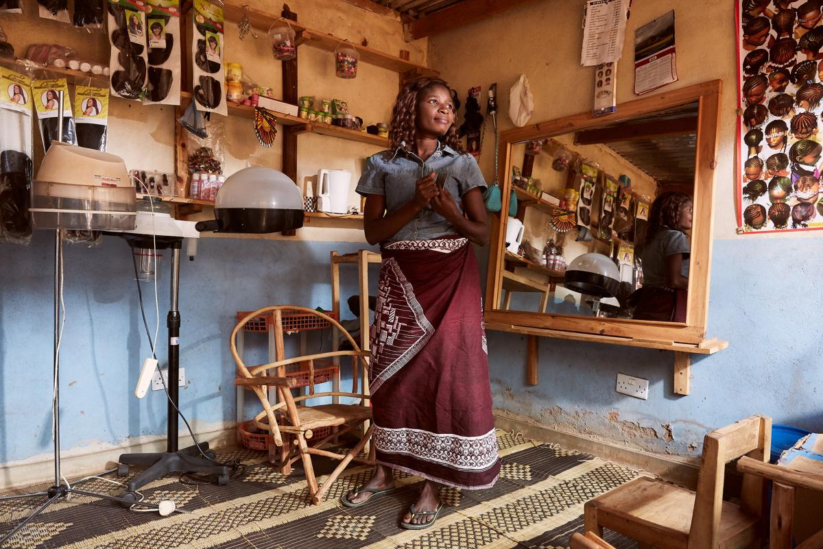 Chrissy Masala in her hairdressing salon in Mpyupyu, Malawi. For five years, Masala says she would have sex with fisherman and be paid with fish, which she would sell at local markets and big cities. But she felt that the community disapproved. Eventually