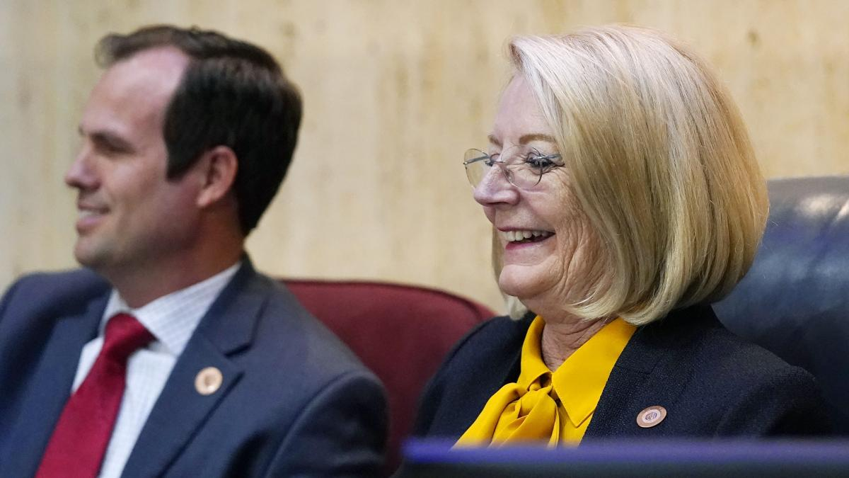 Arizona Senate President Karen Fann (right) smiles as she is joined by state Sen. Warren Petersen, a fellow Republican, prior to Friday's presentation on the Maricopa County election review.